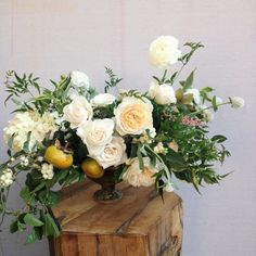 TABLESCAPE: Tinge Floral: also intrigued by the fruit in the bouquet - adds to the overall feeling of it being freshly pulled from a garden