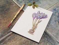 Artist Embroiders Notebook With Veins, Holograms, And Floral Patterns