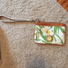 Dooney and Bourke wristlet Adorable design used only once !! Authentic! Dooney & Bourke Bags Clutches & Wristlets