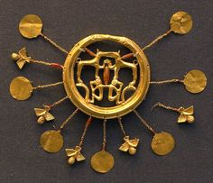 Gold Minoan earring (GR1892.5-20.10-13), one of a pair. Part of the Aegina Treasure from Mallia.