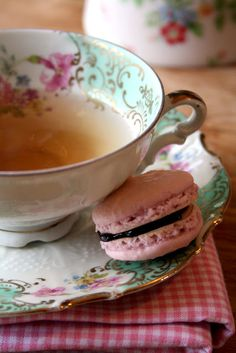 Pink macaroons and tea in a china cup!