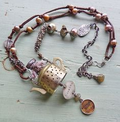 Nina Bagley. Jewelry artist. CrAZy in Love with her pieces. (They equal a car payment in some states.) Love her work.