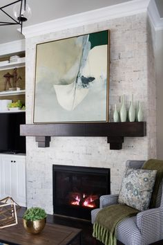 A cozy floor-to-ceiling fireplace, walls of glass, and chic furnishings define this home's central gathering space.