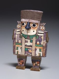 Peru, South Coast, Wari culture Middle Horizon, c. 7th–11th century A.D. c. A.D. 600–1000 Wood with shell-and-stone inlay and silver 4 x 2 1/2 x 1 in. (10.2 x 6.4 x 2.6 cm)