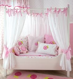 What is it about drapes and canopies that make a girls room so...girly? These canopies are in a soft white with pink stars beautifully embroidered on.
