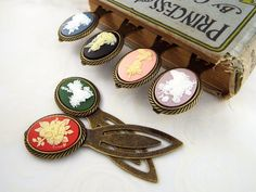 Cameo Fairy Metal Clip Bookmark - Bronze Tone Black Blue Green Pink Purple or Red by fripparie from fripparie. Visit http://ift.tt/1o0ATec for more awesome steampunk fantasy and goth jewelry and accessories.