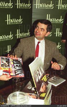 Rowan Atkinson as Mr. Bean gives autographs