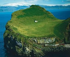 """This enchanting house is located on an island called Elliðaey near Vestmannaeyjar, a small archipelago off the south coast of Iceland. In 2000 the house was given to singer, Bjork from her motherland as a """"Thank You"""" for putting Iceland on the international map."""
