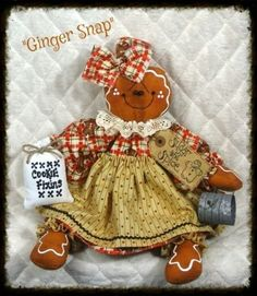 "She is made of a gingerbread colored fabric with a stitched face, beaded eyes, and hand painted ""icing""! Description from ebay.com. I searched for this on bing.com/images"
