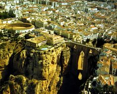 Spain city Ronda, situated in a very mountainous area about 750 m above mean sea level  http://en.wikipedia.org/wiki/Ronda