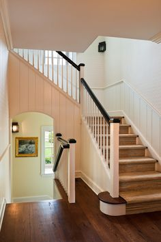 Staircase, with arched hallway