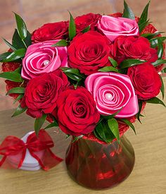 Bunches.co.uk Eternal Roses SDETRS A beautiful gift of Valentines Roses includes seven Upper Class red Roses together with three keepsake pink satin Roses. Beautifully finished with glossy Ruscus leaves and displayed in a red Sisal hea http://www.comparestoreprices.co.uk/flowers-and-flower-delivery/bunches-co-uk-eternal-roses-sdetrs.asp