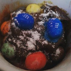 2 mins microwaved mnm and icing sugar-topped brownie in cup