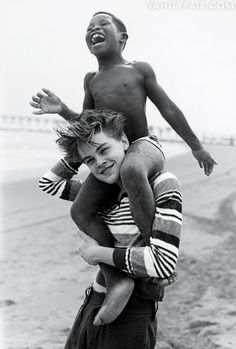 Two kids circa What's Eating Gilbert Grape. And what a novelty - Leonardo DiCaprio cavorting on a beach without a Victoria's Secret model!    Photos: The 2013 Hollywood Portfolio | Vanity Fair