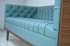The beautiful Koening Place Blue Faux Leather Sofa