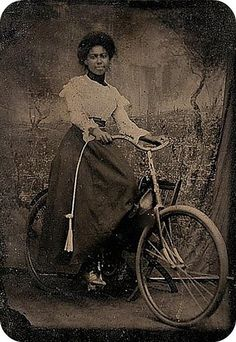 Unknown Woman on a Bicycle