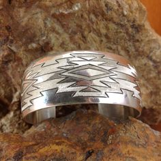 """Solid Sterling Cuff Bracelet with engraved design. Handcrafted by Navajo Artists and Silversmiths. Artist : Veronica Largo Cuff Size:Medium 6 1/4"""" Width: 1"""" Black Arrow Jewelry & Art - Engraved Jewelr"""