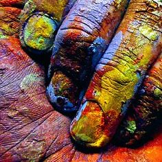 Artist's hand. Art is created two places on canvass and on the hands of the artist.