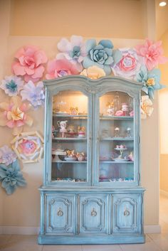 In love with this gorgeous vintage china cabinet and a perfect party decor element in this Marie Antoinette 1st birthday party on www.prettymyparty.com.