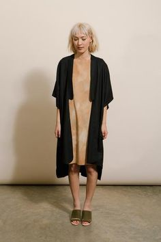 Durable, nubby raw silk kimono-style jacket. Two half-moon pockets hide in the side seams. Features a rounded lapel neck trim and rounded hemline.Made by Laurs Kempexclusively for Goodwin.    Black  100% Raw Silk  One Size  Handmade in Portland, Oregon      Pre-treat any stains. Hand wash gently in hot water and air dry.      Questions about this product? Email info@shopgoodwin.com. We are here to help!