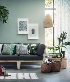 Luonnonvalkoinen/Tummanvihreä. Puuvillatyynynpäällinen. Painettu lehtikuviointi ja piilovetoketju.