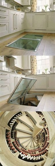 kitchen with hidden wine cellar this would be awesome to have! but i would be afraid to walk on the glass.
