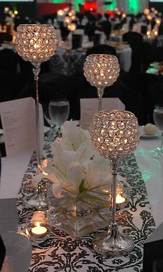 Crystal candleholders and black and white runner Crystal candleholders and black and white runner. Bling Wedding Centerpieces, Bling Centerpiece, Crystal Centerpieces, Crystal Candelabra, Diy Centerpieces, Wedding Decorations, Centrepieces, White Runners, Sparkle Wedding