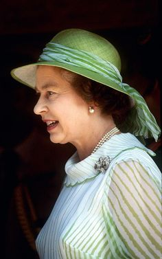 The Queen 1983    Queen Elizabeth II wearing a striped green dress with…