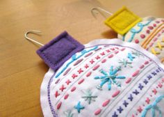 http://michelleclement.typepad.com/blog/2010/12/orn_diy.html amazing free pattern and tutorial on how to make these incredibly charming embroidered handmade ornaments.