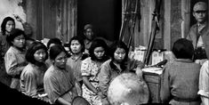 """Chinese """"comfort women"""" are photographed with their Japanese captors. """"Comfort women"""" were women and girls in Japanese occupied countries who were forced into a prostitution corps created by Empire of..."""