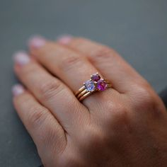 An oval, purple sapphire set in 14K solid yellow gold