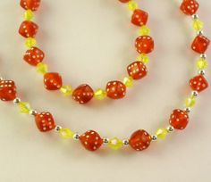 Red and yellow dice bracelet and necklace set.