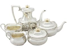 Sterling Silver Five Piece Tea and Coffee Service - Antique Edward VIII  SKU: A3853 Price  GBP £2,950.00  http://www.acsilver.co.uk/shop/pc/Sterling-Silver-Five-Piece-Tea-and-Coffee-Service-Antique-Edward-VIII-67p5576.htm#.VkCAub88rfc