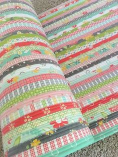 Carried Away Quilting makes a jelly roll rug. Pattern by RJ Designs. Fabric by Corey Yoder for Moda (Flower Mill)