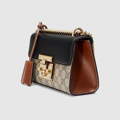 Shop the Padlock small GG shoulder bag by Gucci. A small structured GG Supreme canvas bag with a leather top and our key lock closure. The sliding chain strap can be worn multiple ways, changing between a shoulder and a top handle bag. Burberry Handbags, Prada Handbags, Luxury Handbags, Fashion Handbags, Purses And Handbags, Leather Handbags, Cheap Handbags, Gucci Bags, Prada Tote