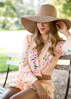 A floppy hat and florals.