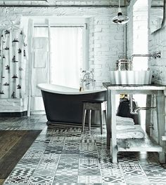 """bathroom is softened with cement tiles in vintage style, designed by Paola Navone and bath Monopoly (London), while the basin """"Doppio Zero"""" from Flamina standing on a rough table in reclaimed timber and stone countertop. Grey Bathrooms, Beautiful Bathrooms, White Bathroom, Luxury Bathrooms, Bidet Wc, Loft Industrial, Industrial Interiors, Paola Navone, Black And White Tiles"""