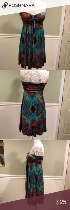 India Boutique Colorful Strapless Dress Boho vibe, very colorful. Pairs effortlessly with turquoise jewelry and sandals. Cups are built in, so no bra required. Runs big, more like a large. India Boutique Dresses Strapless