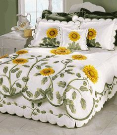 Not keen on the sunflowers, but I love the holistic approach to the quilt, valance and pillow shams, and the way the quilt design grows from the bottom. Also the scalloped edge.Sunflower Quilts I could make a quilted dust ruffleSunflower Quilts would