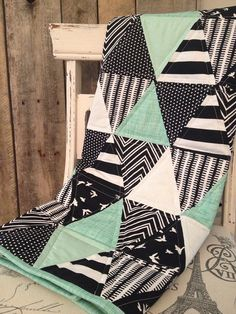 Hey, I found this really awesome Etsy listing at https://www.etsy.com/listing/184833562/black-and-mint-triangle-baby-quilt