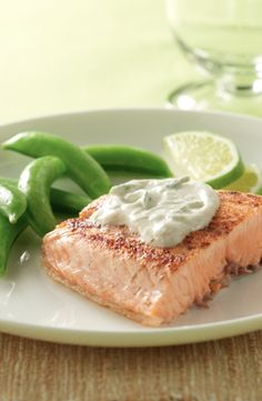 Salmon with Cream Lime Sauce... In 20 minutes and just under 300 calories per serving, you will have a heart healthy seafood dish. The sour lime sauce will give a pop to your savory salmon and will taste refreshing on a hot summer night.
