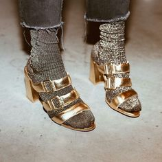 gold strappy mules worn with silver shimmery socks, socks and sandals look, gold shimmery mule shoes on a block heel, Sock Shoes, Flat Shoes, Socks Outfit, Parisian Girl, Socks And Sandals, Gold Sandals, Gold Heels, Metallic Sandals, Oldschool