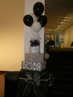 Gift wrapped boxes and balloons on sticks for party decorations  (facility did not allow helium so had to be creative)