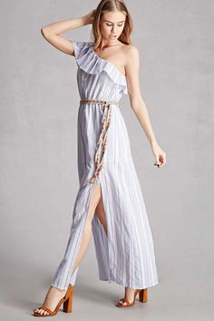 A woven maxi dress featuring a stripe pattern, one-shoulder design, ruffled layer, an elasticized waist with a colorful woven belt, a partially lined skirt, and an M-slit. This is an independent brand and not a Forever 21 branded item.