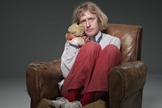 """British Turner Prize-winning artist Grayson Perry with his childhood teddy-bear Alan Measles. Alan features large in many of the artist's work (ceramics, tapestries, sculpture …). Perry: """"He was the benign dictator of my childhood imaginary world. … Now he is a guru and living god in my personal cosmology."""" Alan accompanied Perry on a pilgrimage to Germany as a precursor to the fantastic and highly praised exhibition """"Tomb of the Unknown Craftsman"""" housed by the British Museum in 2011."""