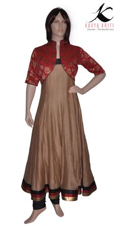 Classy chanderi cotton chudidar in earthy colors,elegantly embellished a short jacket with brocade fabric.