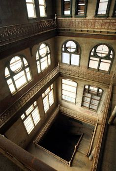 The abandoned Tennessee Brewery - inside is the four story atrium with ornamental staircases. Memphis, Tennessee.