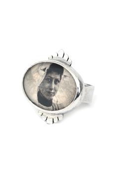 'Oblivion', ring, 2013, silver, glass, old postcard. Made by Malou Paul. www.maloupaul.nl