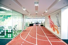 Asics Australian Headquarters Uses graphics combined with activity areas to successfully communicate the brand.