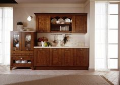 This kitchen is also efficient and always tidy, thanks to the capacious wall units and cupboards.